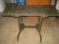 METAL TABLE WITH FOLD DOWN ENDS. 34 INCHES LONG, 14