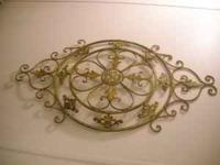 Gold metal wall decoration 42 inches x 24 inches. Email