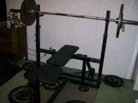Set includes: Bench with leg curl extension, 45lb bar