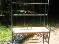 Green metal wine rack with vines. Cash