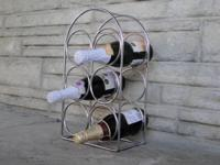 Simple metal 6 bottle wine rack. Great for home decor,