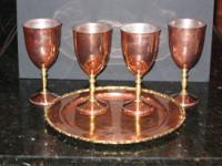 Thirteen hand-crafted Mexican pieces of copper and
