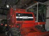 Massey Ferguson 550 Combine, with 444 corn head, 9115