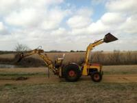 MS 35 with loader and back hoe. All hydraulics work. 35