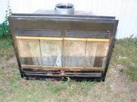 MH fireplace insert - used - $200 - black face with