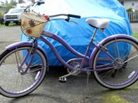 This a beautiful violet Micargi 7speed Cruiser which I