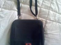 Never used,Can be used as a cross body or hand bag.