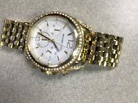 Michael kors all gold watch with all links. Only had 2