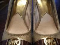Michael kors shoes gold wedge. Worn 2 times too small.