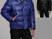 This Michael Kors down coat features four pockets at