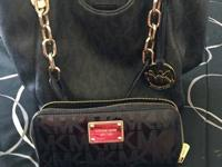 I'm selling this Michael Kors handbag with wallet. It's