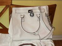 Michael Kors white/light cream bag. This purse is 1.5