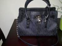 I am selling an authentic Michael Kors handbag. It's in