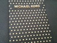 I have Michael Kors wristlet. Asking price is $60.00
