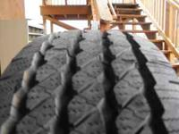 one michelin cross/terrain tire,was a covered spair,