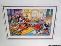This cute Mickey Mouse picture has a gold frame &