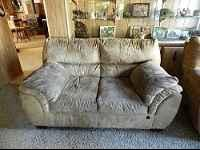 MICRO FIBER LOVE SEAT AND MATCHING RECLINER FOR SALE.