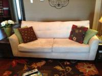Microfiber ivory couch. Tufted back, scotch guarded,