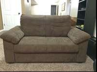 This is a dark brown microfiber loveseat bought two