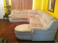 Tan microfiber sectional sofa with chase lounge on one