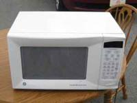 1000 Watt GE Microwave call Dave at  Location: