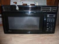 Black Microwave in good condition, works great, has