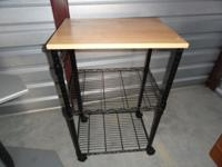 Basic microwave cart for sale. Black metal legs and