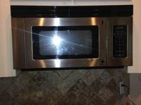 microwave, over the range, stainless.  cooks great,