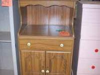 PRE OWED IN GOOD CONDITION MICROWAVE STAND. CABINET