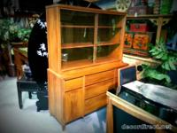 This Mid Century Show Cabinet in walnut has terrific