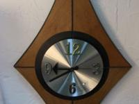 Beautiful clock inset in a wooden diamond. Great wall