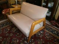 Very stylish Mid Century loveseat in beige with wood
