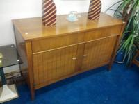 For sale we have a Mid Century Modern walnut server. It