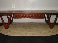 This mid century modern walnut coffee table is made by