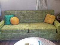 Gorgeous mid century couch sleeper. It has wheels in