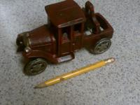 This is a Mid Century Vintage cast iron model-t truck.