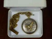 Milan pocket watch has a brushed metal case with
