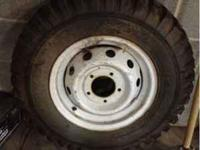 Military tire 7.00x16 tire and wheel new dirty from