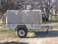 military trailer ,1500lb cap. ,dump body ,new tires ,