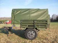 MODEL M105 MILITARY TRAILER W/ SIDE BOARDS AND COVER.