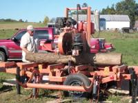 We use a Woodmizer sawmill to mill your logs into