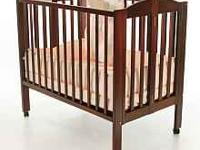 2-in-1 Portable Folding Crib in Cherry, features a US