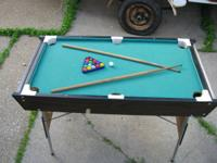 This is a sturdy, foldable, miniature pool table that