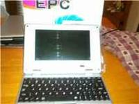 MINI LAPTOP FOR SALE NEW IN BOX RED IN COLOR GREAT