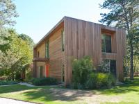 Set on two beautifully landscaped acres down a long