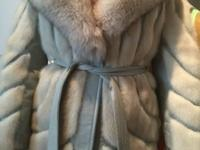 Grey leather with grey mink size is small probably an