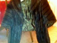 Fully lined mink stole in excellent condition. $100.00