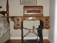 This early 1900 antique sewing machine is in mint