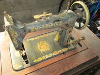 Antique Minnesota (Sears) sewing machine. Cabinet is in