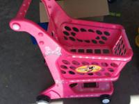 Up for sale is a pink Minnie mouse grocery cart